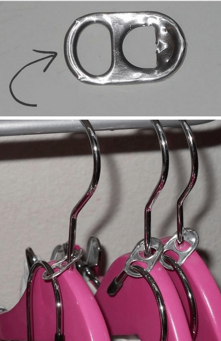 soda can used as additional hanger space in closet